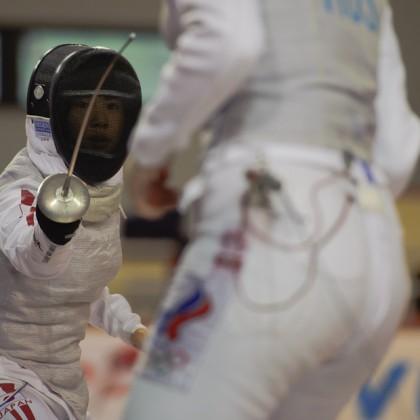 Útok Karin Myawaki (JPN) proti Isverlana Tripapina (RUS) počas Memoriálu Ferdinand de Martinengo 2011, atletická hala Elán, Bratislava, Sobota 19.11.2011